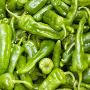 a basket of green chili peppers from farmers market
